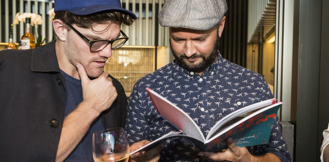 Two chaps reading the MQFF 2018 program